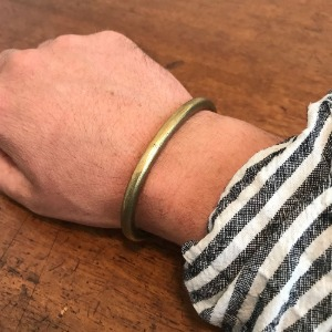 Tender & Co. Plautus Face Wrist Torc Polished Brass